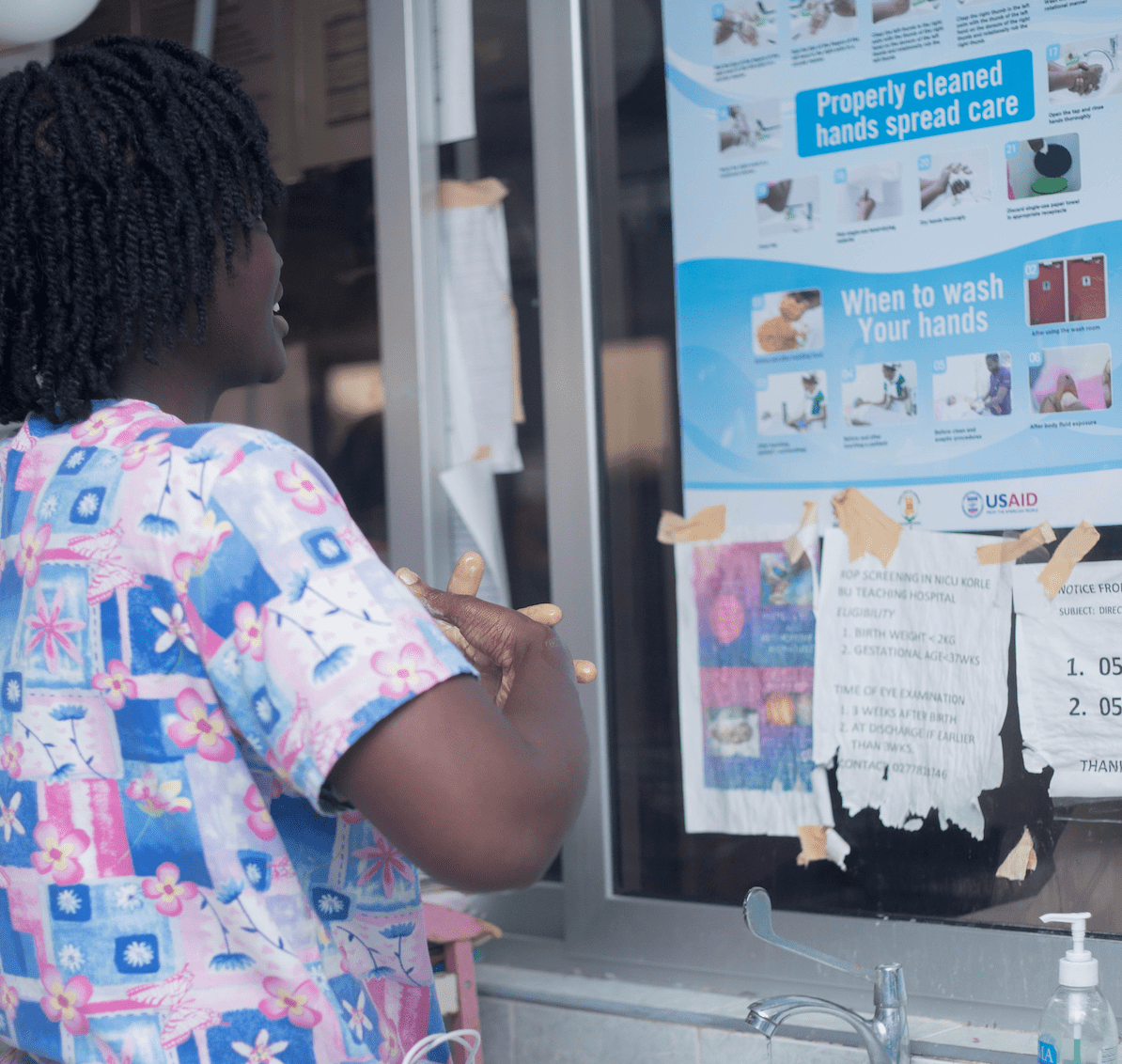 A nurse in Korle- Bu Teaching hospital is practicing her hand hygiene